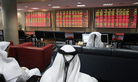 Investors monitor market activity at the Qatar Exchange in Doha September 11, 2011. REUTERS/Mohammed Dabbous