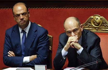 Italy's Prime Minister Enrico Letta (R) looks on next to Interior Minister Angelino Alfano during a vote session at the Senate in Rome in this July 19, 2013 file photo. REUTERS/Remo Casilli/Files