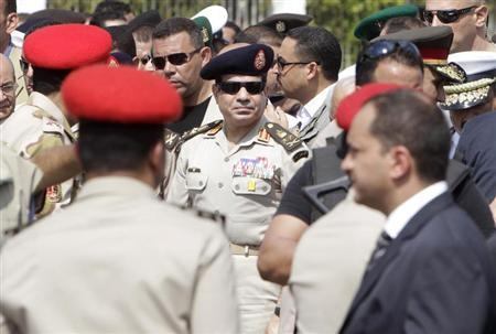 Army Chief General Abdel Fattah al-Sisi (C) attends the military funeral service of Police General Nabil Farag, in Cairo's Nasr City district September 20, 2013. REUTERS/Mohamed Abd El Ghany