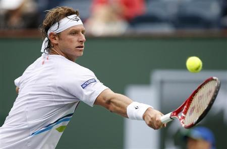 David Nalbandian of Argentina returns a shot against Marcel Granollers of Spain during their match at the BNP Paribas Open ATP tennis tournament in Indian Wells, California, March 7, 2013 in this file picture. REUTERS/Danny Moloshok