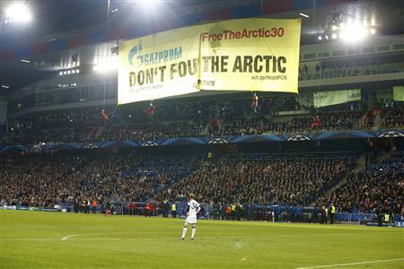 Environmental activists unfurl a protest banner against Gazprom, Schalke 04's main sponsor, before the Champions League Group E football match between Schalke 04 and Basel at St. Jakob-Park in Basel October 1, 2013. REUTERS/Arnd Wiegmann