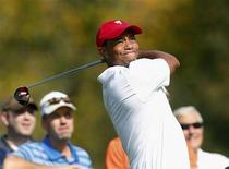 U.S. team member Tiger Woods hits off the third tee during the first practice round for the 2013 Presidents Cup golf tournament at Muirfield Village Golf Club in Dublin, Ohio October 1, 2013. REUTERS/Chris Keane