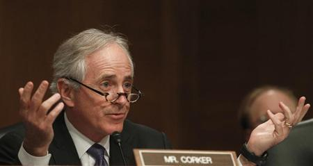 Senator Bob Corker (R-TN) questions members of the panel testifying before the Senate Banking, Housing and Urban Affairs Committee in Washington February 14, 2013. REUTERS/Gary Cameron