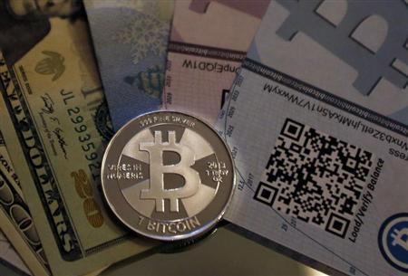 One of Bitcoin enthusiast Mike Caldwell's coins in this photo illustration at his office in Sandy, Utah, September 17, 2013. REUTERS/Jim Urquhart