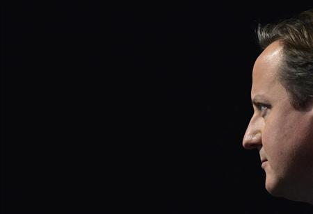 Britain's Prime Minister David Cameron listens as London Mayor Boris Johnson delivers his keynote speech to the Conservative Party annual conference in Manchester, northern England October 1, 2013. REUTERS/Toby Melville
