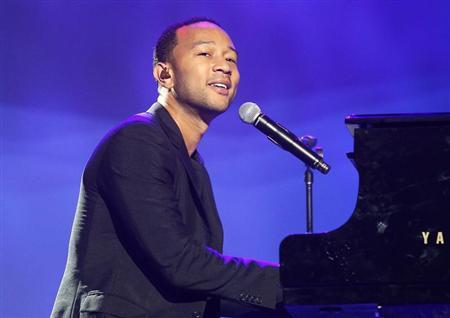 Singer John Legend performs at the annual shareholders meeting for Walmart in Fayetteville, Arkansas June 7, 2013. REUTERS/Rick Wilking