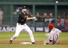 Oct 1, 2013; Pittsburgh, PA, USA; Pittsburgh Pirates second baseman Neil Walker (18) turns a double play over Cincinnati Reds shortstop Zack Cozart (2) in the fifth inning of the National League wild card playoff baseball game at PNC Park. Mandatory Credit: Charles LeClaire-USA TODAY Sports