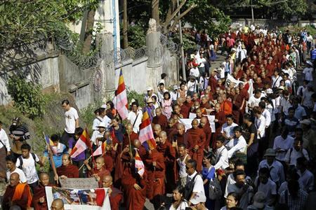 Buddhist monks take part in a protest in support of demonstrators who were injured during a copper mine riot, in Yangon December 12, 2012. REUTERS/Soe Zeya Tun