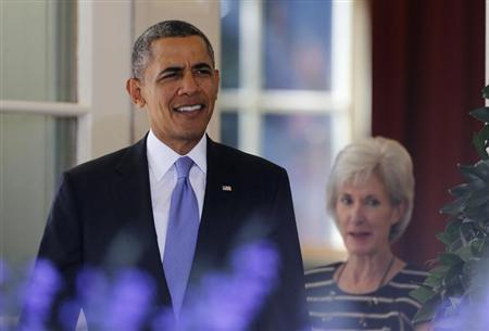 U.S. President Barack Obama walks out to deliver remarks alongside Human Services Secretary Kathleen Sebelius (R) and other Americans the White House says will benefit from the opening of health insurance marketplaces under the Affordable Care Act, in the Rose Garden of the White House in Washington, October 1, 2013. REUTERS/Larry Downing