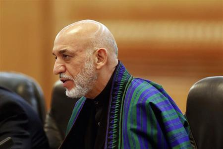 Afghan President Hamid Karzai meets with Chinese President Xi Jinping (not pictured) at the Great Hall of the People in Beijing September 27, 2013. REUTERS/Lintao Zhang/Pool
