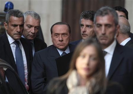 Italy's former prime minister Silvio Berlusconi (C) arrives at the lower house of parliament in Rome September 30, 2013. REUTERS/Remo Casilli