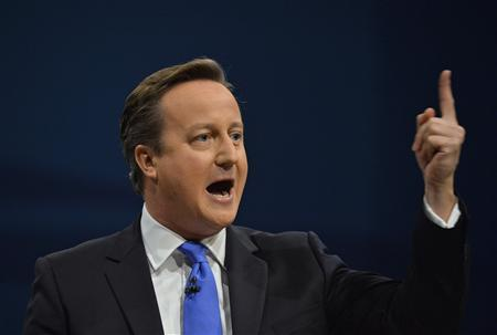 Britain's Prime Minister David Cameron delivers his keynote address to the Conservative Party annual conference in Manchester, northern England October 2, 2013. REUTERS/Toby Melville