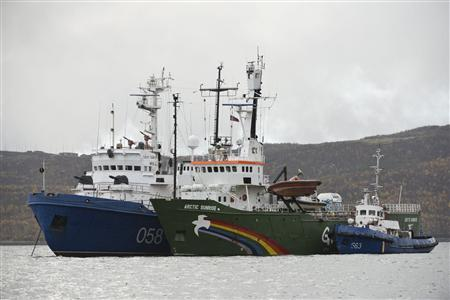 Greenpeace ship ''Arctic Sunrise'' (C) is seen anchored outside the Arctic port city of Murmansk, on the day when members of Russian Investigation Committee conducted an inspection onboard the Greenpeace ship, in this September 28, 2013 handout provided by Greenpeace. REUTERS/Dmitri Sharomov/Greenpeace/Handout via Reuters