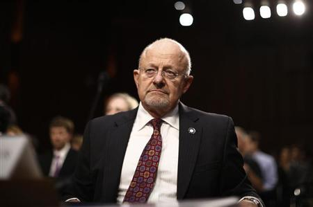 U.S. Director of National Intelligence James Clapper reacts as he testifies at a Senate Intelligence Committee hearing the Foreign Intelligence Surveillance Act legislation on Capitol Hill in Washington, September 26, 2013. REUTERS/Jason Reed