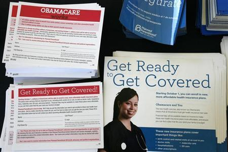 Information cards are stacked on a table during an Affordable Care Act outreach event for the Latino community in Los Angeles, California September 28, 2013. REUTERS/Jonathan Alcorn