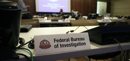 Phone banks dedicated to the Federal Bureau of Investigation are shown during a tour of the Multi-Agency Communications Center (MACC) at an undisclosed location in the Chicago suburbs May 17, 2012. REUTERS/Frank Polich