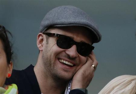 Singer/actor Justin Timberlake watches Rafael Nadal of Spain face Novak Djokovic of Serbia in the men's final match at the U.S. Open tennis championships in New York, September 9, 2013. REUTERS/Mike Segar