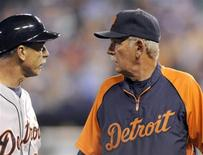 Detroit Tigers manager Jim Leyland (R) talks with third base coach Tom Brookens after Omar Infante's three-run double against the Kansas City Royals in the fifth inning of their MLB American League baseball game in Kansas City, Missouri September 6, 2013. REUTERS/Dave Kaup