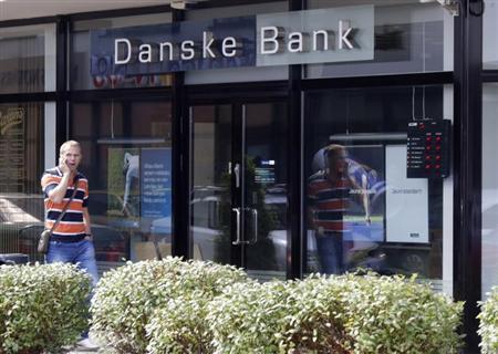 A man walks past a Danske bank branch in Riga August 1, 2013. REUTERS/Ints Kalnins