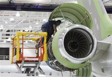 A worker looks at an engine on a Bombardier Global 5000 jet as its being assembled at the Bombardier aircraft manufacturing facility in Toronto, November 25, 2010. REUTERS/Mark Blinch