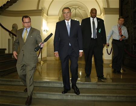 U.S. House Speaker John Boehner (R-OH) (2nd L) departs for a meeting at the White House with President Barack Obama, from the U.S. Capitol in Washington, October 2, 2013. REUTERS/Jonathan Ernst
