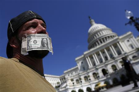John Zangas, who identified himself as a federal employee, protests against the current government shutdown at the U.S. Capitol in Washington, October 2, 2013. REUTERS/Jonathan Ernst