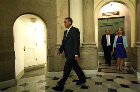 U.S. House Speaker John Boehner (L) departs his office with his staff to go to the House floor for a series of votes on partial budget measures to send to the Democratic-controlled Senate at the U.S. Capitol in Washington October 1, 2013. REUTERS/Jonathan Ernst
