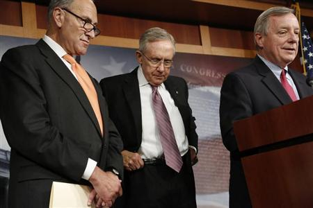U.S. Senate Majority Leader Harry Reid (D-NV) (C) hitches up his belt during a news conference with Senator Charles Schumer (D-NY) (L) and Senator Richard Durbin (D-IL) at the U.S. Capitol in Washington, October 2, 2013. REUTERS/Jonathan Ernst