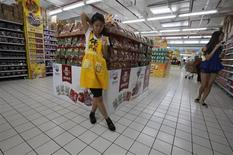 A worker waits for customers at a supermarket in Beijing July 16, 2013. REUTERS/Kim Kyung-Hoon