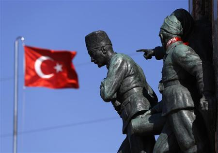 A Turkish flag flutters near the monument of Mustafa Kemal Ataturk at Taksim Square in Istanbul June 24, 2013. REUTERS/Marko Djurica