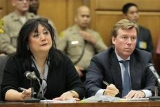 Attorneys for Katherine Jackson, Deborah Chang and Kevin Boyle (R) listen as jurors are polled following the verdict in Jackson's civil lawsuit against AEG Live at the Los Angeles Superior Court in Los Angeles, October 2, 2013. REUTERS/Robert Gauthier/Pool
