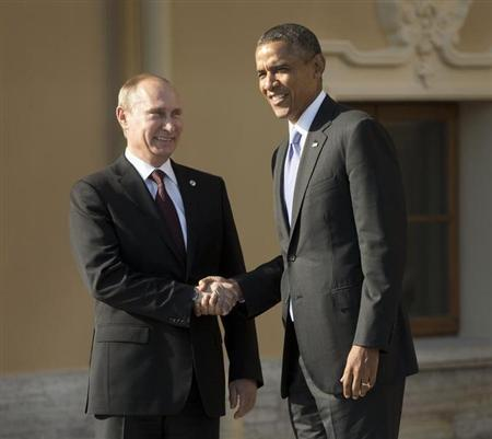 U.S. President Barack Obama (R) and Russia's President Vladimir Putin shake hands during arrivals for the G20 summit at the Konstantin Palace in St. Petersburg, September 5, 2013. REUTERS/Pablo Martinez Monsivais/Pool