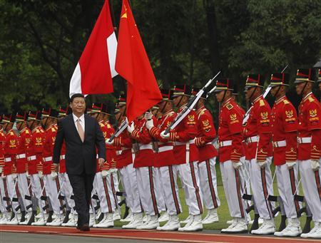 China's President Xi Jinping walks during a welcoming ceremony at the Presidential Palace in Jakarta October 2, 2013. REUTERS/Supri
