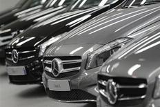 Mercedes-Benz A-class cars are displayed in a dealership of German car manufacturer Daimler in Paris, July 30, 2013. REUTERS/Christian Hartmann