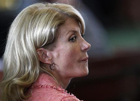 Democratic Senator Wendy Davis listens as the state Senate meets to consider legislation restricting abortion rights in Austin, Texas July 12, 2013. REUTERS/Mike Stone