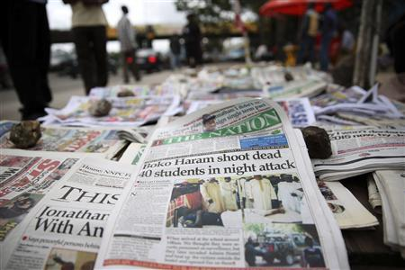 A newspaper is displayed at a vendor stand in Ikoyi district in Lagos September 30, 2013. REUTERS/Akintunde Akinleye