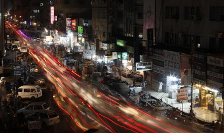 A view is seen of a busy street in Karachi June 29, 2013. REUTERS/Akhtar Soomro