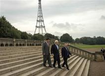 Mayor of London Boris Johnson (C) flanked by Chairman of ZhongRong Group Ni Zhaixing (L) and leader of Bromley Council Stephen Carr walk through Crystal Palace Park in London October 3, 2013. REUTERS/Shadi Bushra