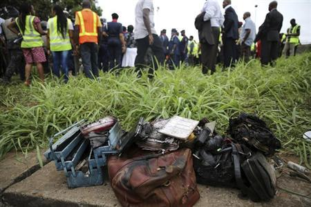 Personal belongings of passengers which have been recovered from a plane after it crashed, are seen near the Lagos international airport October 3, 2013. REUTERS/Akitnunde Akinleye