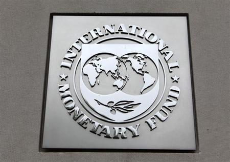 The International Monetary Fund (IMF) logo is seen at the IMF headquarters building during the 2013 REUTERS/Yuri Gripas
