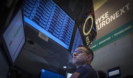 A specialist trader works at his post on the floor of the New York Stock Exchange, October 3, 2013. REUTERS/Brendan McDermid
