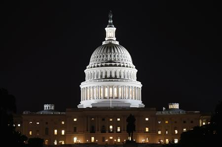 A view of the U.S. Capitol at night, on the eve of a potential federal government shutdown, in Washington September 30, 2013. REUTERS/Kevin Lamarque