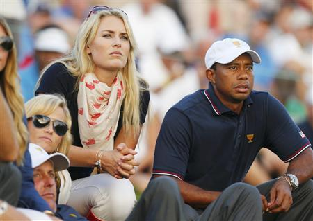 U.S. golfer Tiger Woods and girlfriend Lindsey Vonn sit with teammate Phil Mickelson and Phil's wife Amy (L) as they watch play during the opening Four-ball matches for the 2013 Presidents Cup golf tournament at Muirfield Village Golf Club in Dublin, Ohio October 3, 2013. REUTERS/Chris Keane