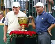 International team captain Nick Price (L) poses next to the Presidents Cup with U.S. team captain Fred Couples before first round play begins in the 2013 Presidents Cup golf tournament at Muirfield Village Golf Club in Dublin, Ohio October 3, 2013. REUTERS/Jeff Haynes
