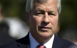 Jamie Dimon, chairman and CEO of JP Morgan Chase, arrives at the White House in Washington, October 2, 2013, for a meeting of the Financial Services Forum with President Barack Obama. REUTERS/Jason Reed