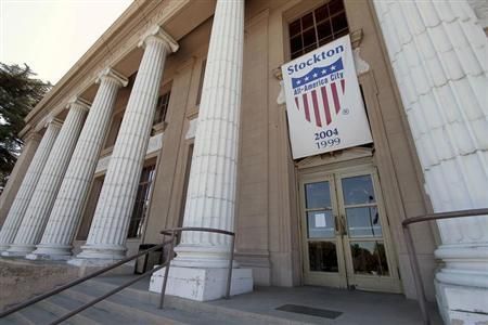An All-America city banner hangs over City Hall in Stockton, California June 27, 2012. REUTERS/Kevin Bartram