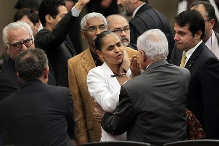 Former Senator Marina Silva is consoled by other lawmakers after the Supreme Electoral Tribunal made the decision not to grant her request to register a new political party named ''Rede Sustentabilidade'' (Sustainability Network), to contest the 2014 presidential elections in Brazil, in Brasilia October 3, 2013. REUTERS/Ueslei Marcelino