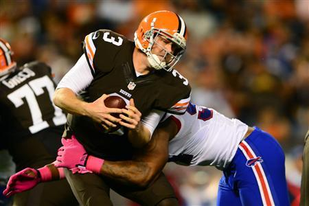 Oct 3, 2013; Cleveland, OH, USA; Cleveland Browns quarterback Brandon Weeden (3) is sacked by Buffalo Bills defensive end Mario Williams (94) during the third quarter at FirstEnergy Stadium. Mandatory Credit: Andrew Weber-USA TODAY Sports