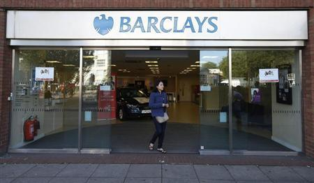 A woman leaves the Swiss Cottage branch of Barclays in London September 20, 2013. REUTERS/Suzanne Plunkett