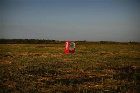 A vending machine, brought inland by a tsunami, is seen in a abandoned rice field inside the exclusion zone at the coastal area near Minamisoma in Fukushima prefecture September 21, 2013. REUTERS/Damir Sagolj